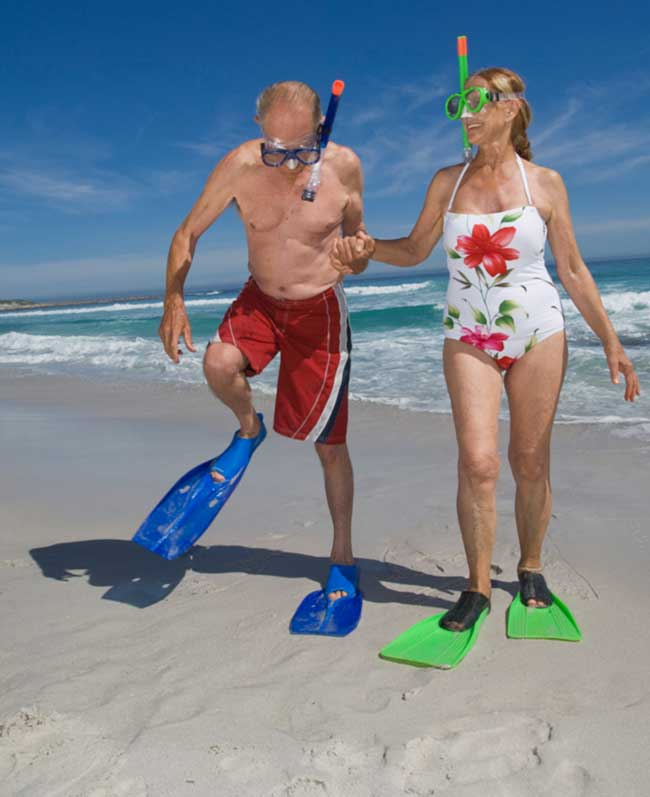 active-senior-couple-with-flippers