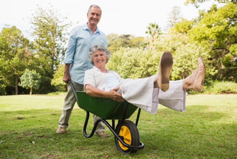 active-senior-in-wheelbarrow