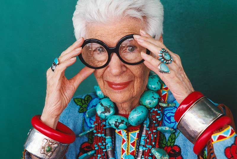 Iris Apfel holding large glasses