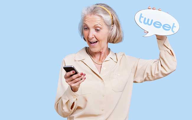 senior-woman-tweeting-on-smartphone