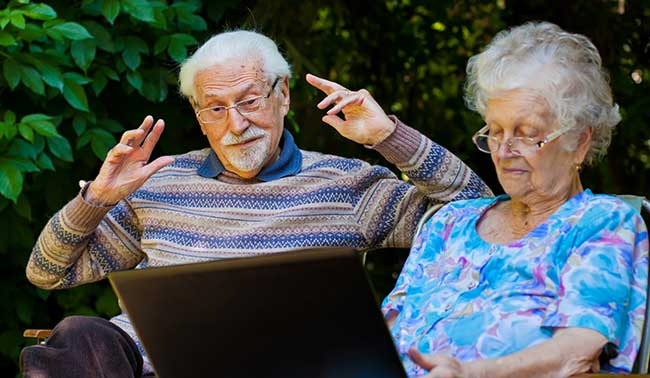 seniors-outdoors-with-laptop
