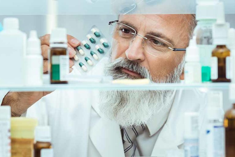 Pharmacist checking medications