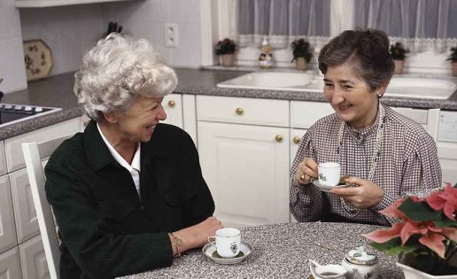 Women having tea in kitchen