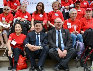 Council Members Peter Koo and Barry S. Grodenchik sat for a photo with the Senior Planet Campaigners.