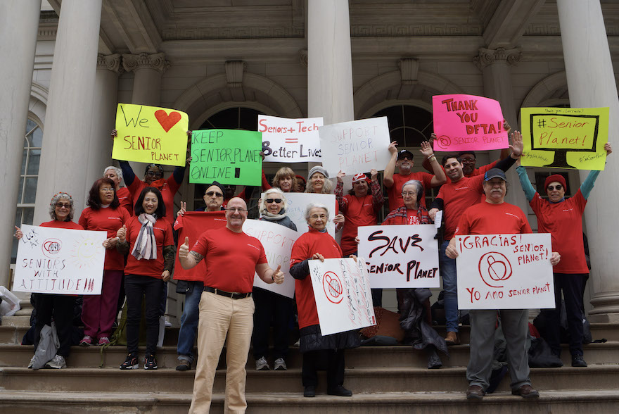 Senior Planet members gather on the steps of New York City Hall