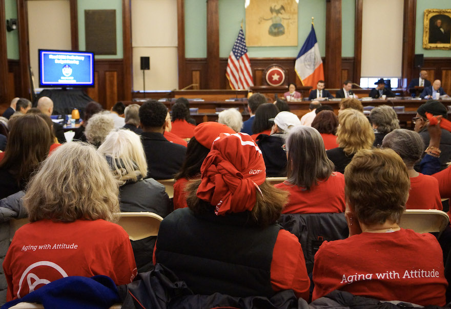 Senior Planet members sit in the City Hall Chamber